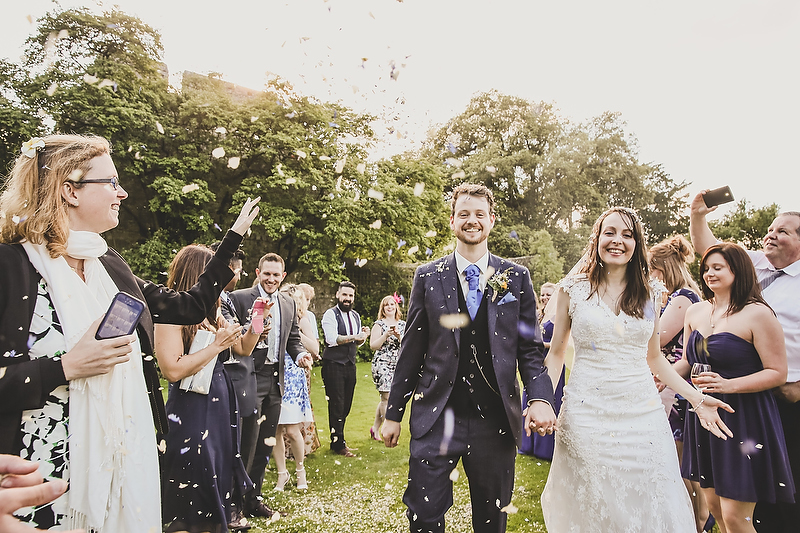 Rhianedd and Peter's rainy summer wedding at Fonmon Castle